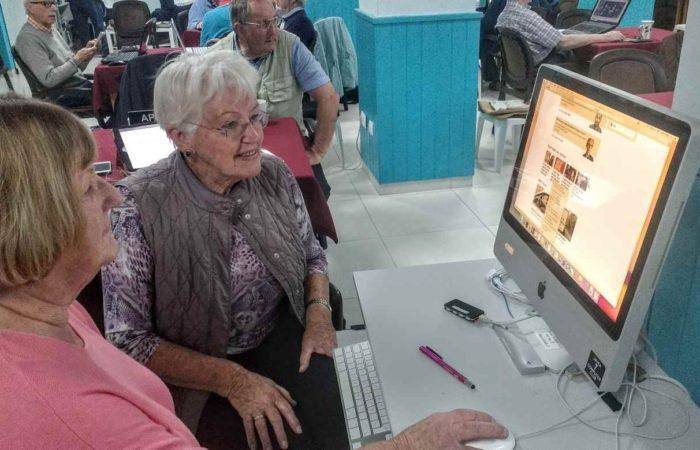 Susan helping an Apple user